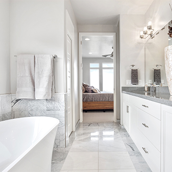 Modern primary bathroom with tile floors