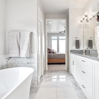 Modern primary bathroom with tile floors
