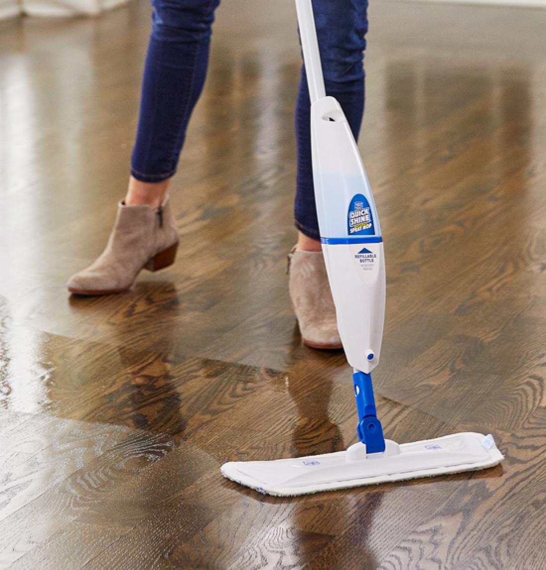 Woman using Multi-Surface Spray Mop