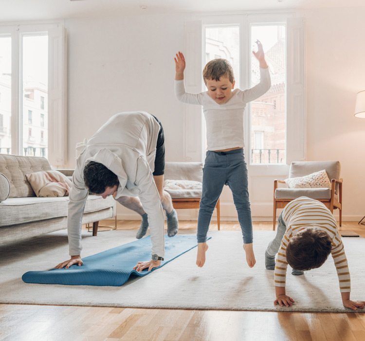 Father exercising with children