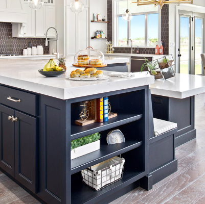 Kitchen with stone countertop surfaces